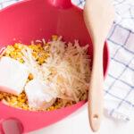 Add cream cheese, Greek yogurt and cheese to corn dip