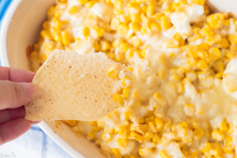 Cheesy Hot Corn Dip on a tortilla chip.