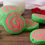 Christmas Pinwheel Cookies served with holiday decorations and a glass of milk.