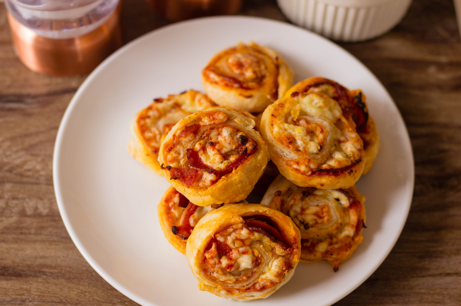 Pepperoni Pinwheels being served on a plate at a party.