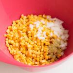 mix together corn, onion, garlic powder and cayenne pepper.