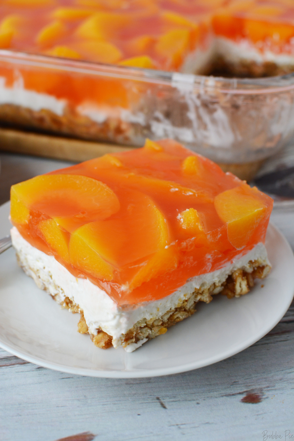 Easy Peach Pretzel Salad being served on a plate.