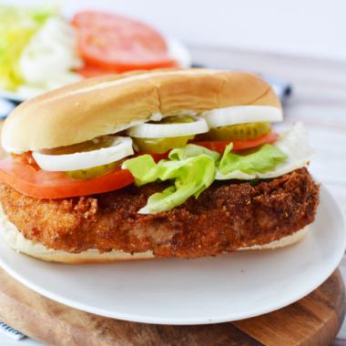 Indiana Pork Tenderloin Sandwich being served on a plate.