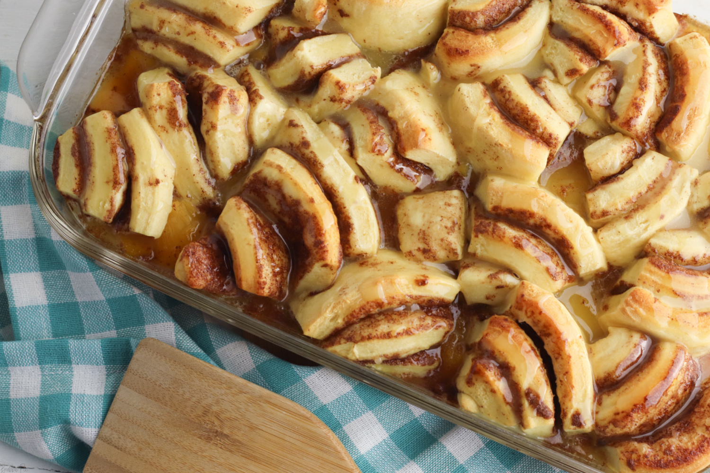Easy Peach Cobbler with Cinnamon Rolls in a casserole dish.