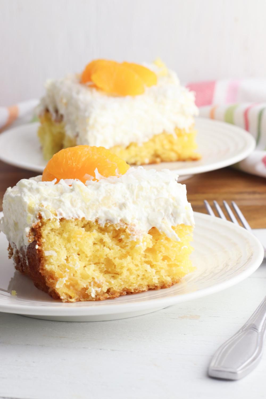 Mandarin Orange Pineapple Cake being served on a white plate.