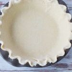 Preparing the premade pie crust for Toll House Pie