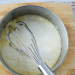 Whisking ingredients to make honey pie