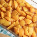 pour peaches into casserole dish