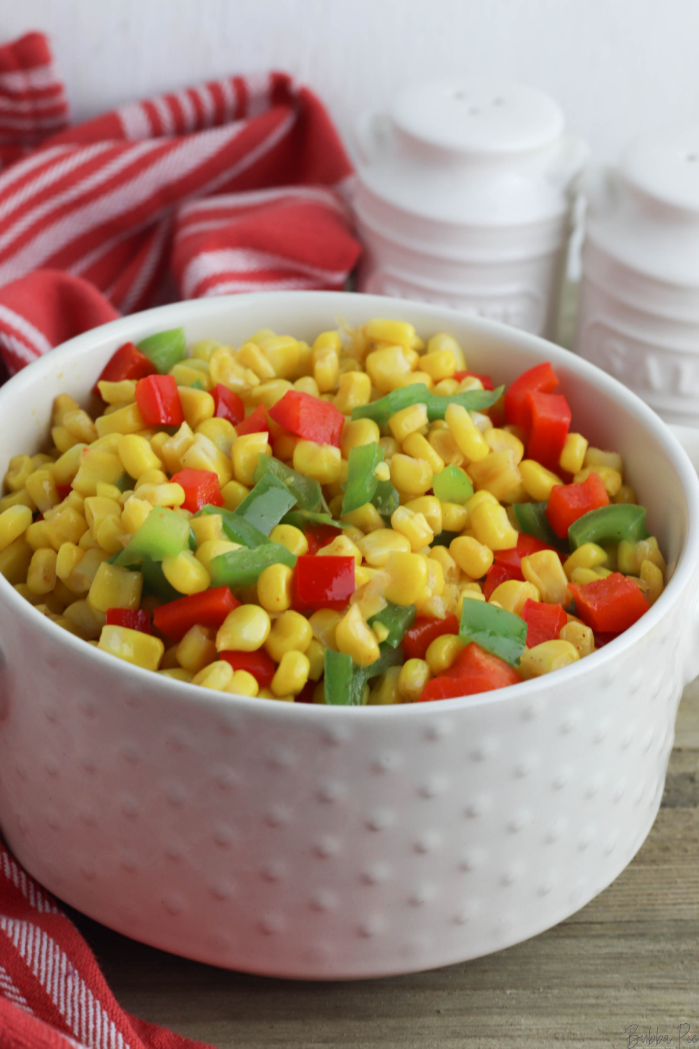 Easy Fiesta Corn being served as a side dish.