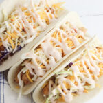 Fried Chicken Tacos with cheese and lettuce.
