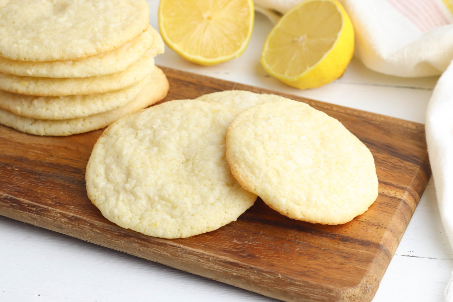 Meyer Lemon Cookies sitting on a counter with lemons.