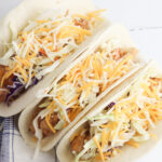 Put chicken in taco, topped with lettuce and cheese