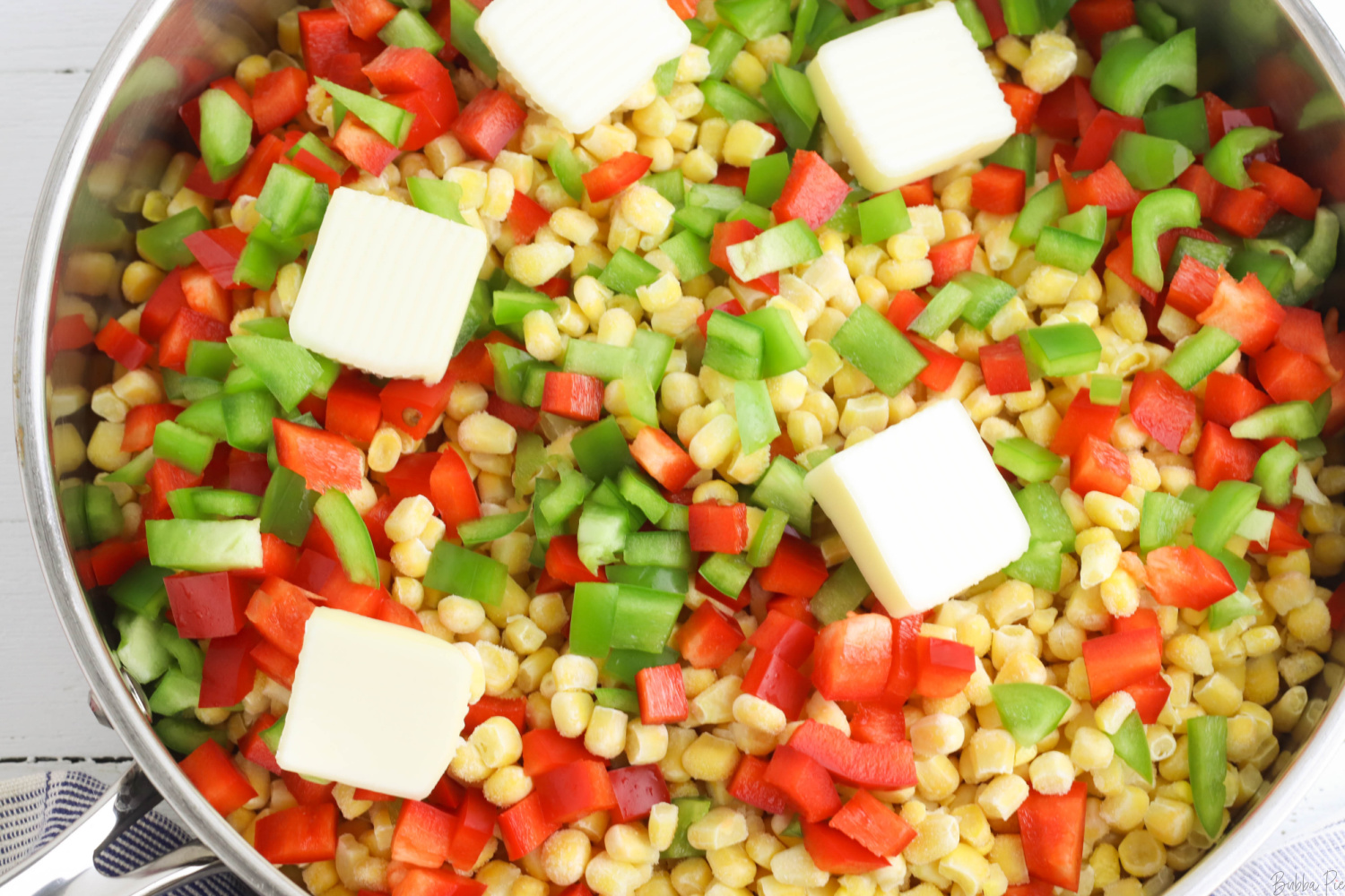 Vegetables and butter in skillet to make fiesta corn.