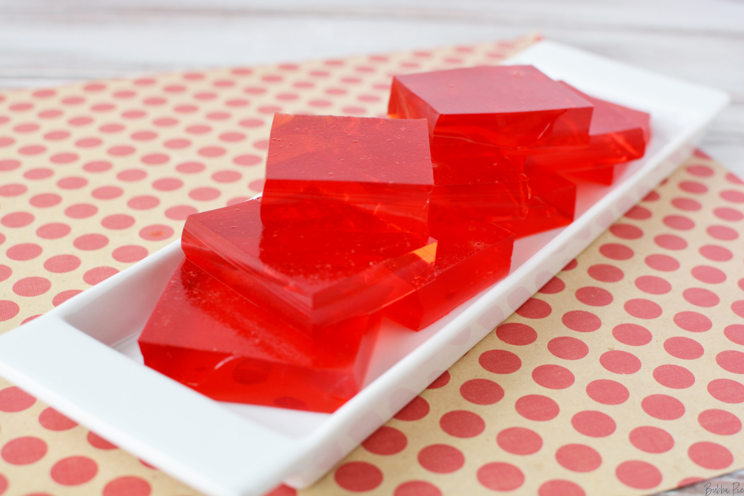 Finger Jello being served on a white plate