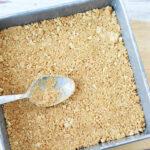 Press graham cracker crust into baking pan