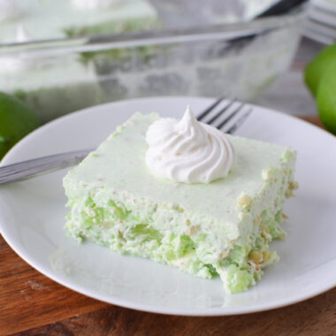 Lime Jello Salad being served on a white plate