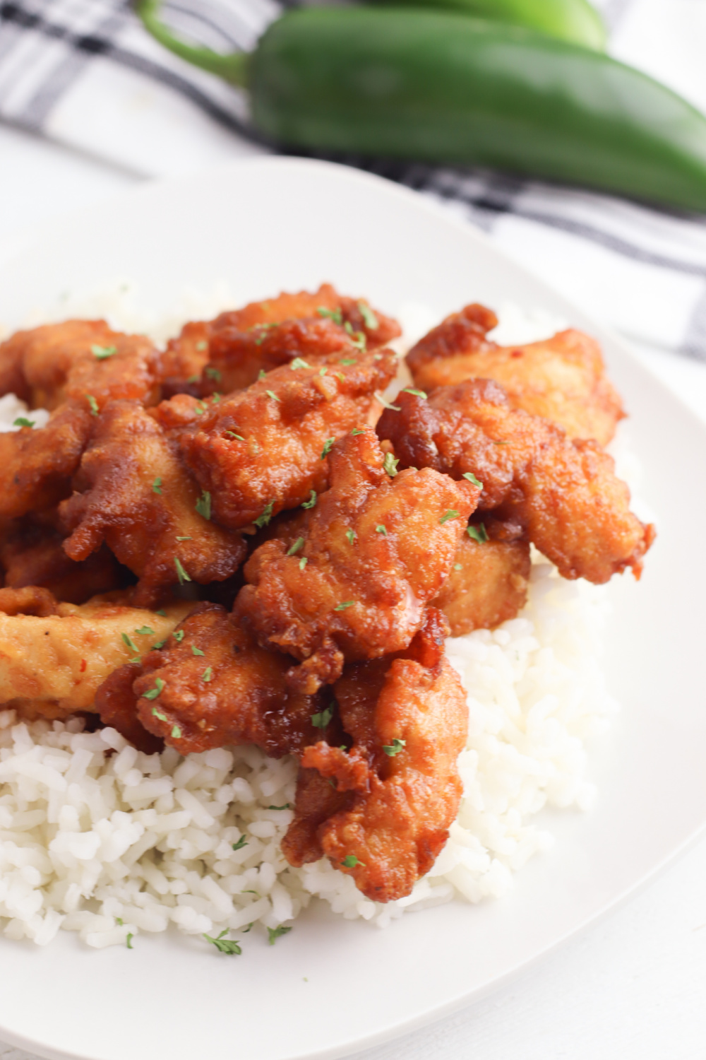 Thai Volcano Chicken Recipe on a bed of rice on a white plate.
