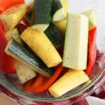 Toss vegetables in oil, salt and garlic powder