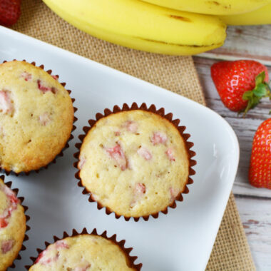Strawberry Banana Muffins in a muffin tin coming out of oven.