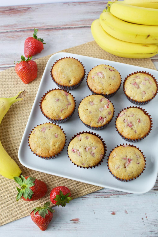 Strawberry Banana Muffins Recipe cooling on baking pan.