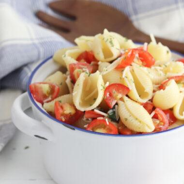 Bruschetta Pasta Salad sitting in a white bowl.