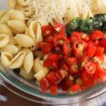 Combine Pasta with bruschetta ingredients