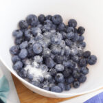 coat blueberries with sugar.