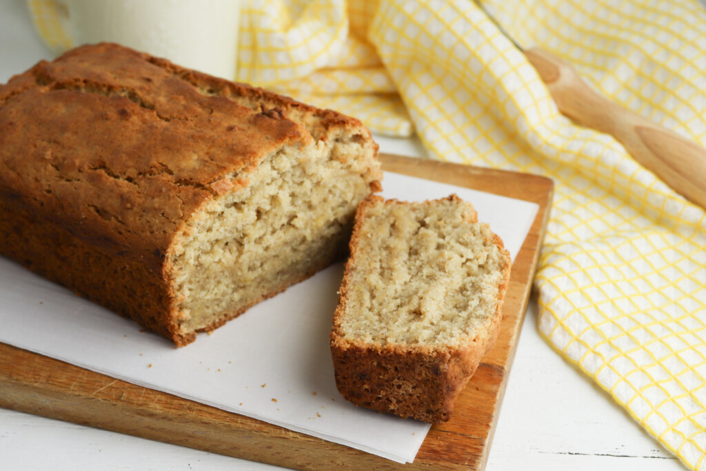 2 banana bread being slice for serving