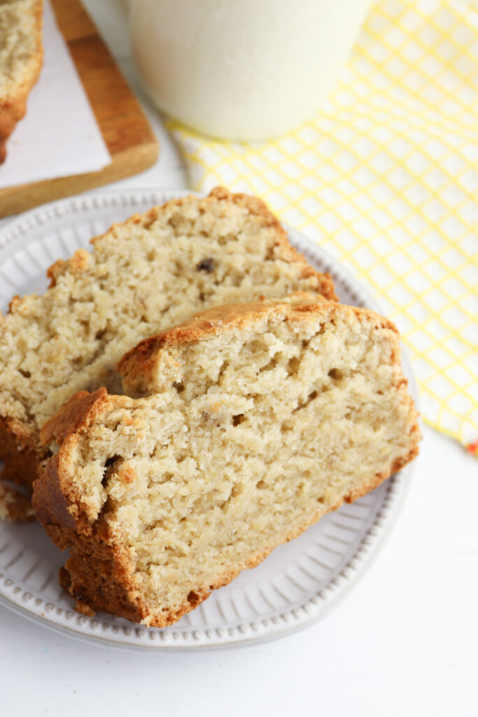 Banana bread slices on a white plate.