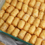 Pour egg mixture over tater tots