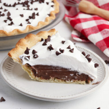 Chocolate Cream Pie being served on a white plate.