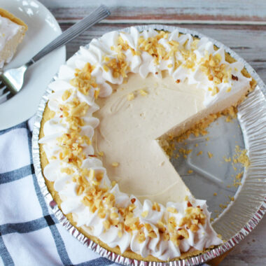 Peanut Butter No Bake Pie being served in a pie plate.